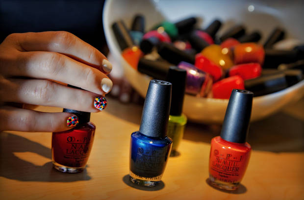 Polka dots in bright colors are a fun and creative way to add interest to your manicure. Nail art by Erin Arnett of Cottonwood Salon Spa. Photo by Chris Landsberger, The Oklahoman. <strong>CHRIS LANDSBERGER</strong>