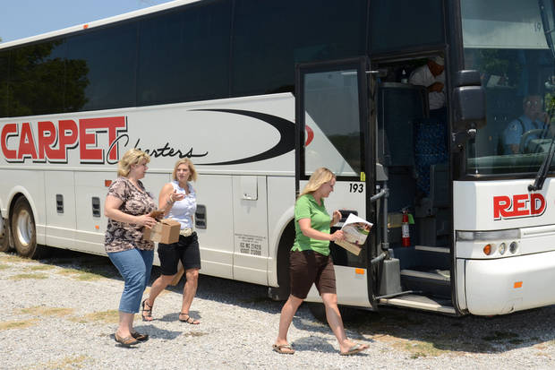 Becca Lasich, eastern region agritourism coordinator for the state Department of Agriculture, Food and Forestry, prepares to board the bus this spring for a rolling workshop touring a variety of agritourism businesses.  PHOTO PROVIDED