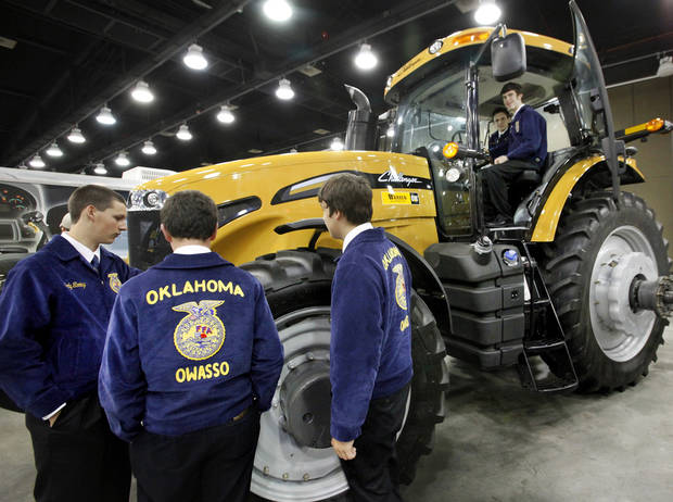 Convention attendees check out a CAT Challenger tractor on display Tuesday as part of the trade show during the annual state convention of FFA members at the Cox Convention Center in Oklahoma City. Photo by Jim Beckel, The Oklahoman