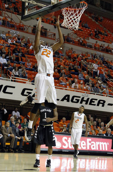 Oklahoma State's Markel Brown (22) dunks in front of Portland State's Lateef McMullan (1) during the college basketball game between Oklahoma State University and Portland State, Sunday,Nov. 25, 2012. Photo by Sarah Phipps, The Oklahoman