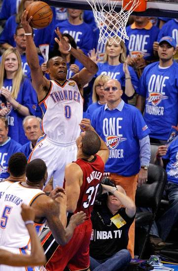 Oklahoma City's Russell Westbrook (0) dunks over Miami's Shane Battier (31) during Game 1 of the NBA Finals between the Oklahoma City Thunder and the Miami Heat at Chesapeake Energy Arena in Oklahoma City, Tuesday, June 12, 2012. Photo by Sarah Phipps, The Oklahoman