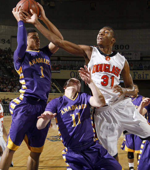 Anadarko's Sheldon Wilson, left, and Jacob Bellamy go for the ball beside Dydrell Post of Douglass during the Class 4A boys high school state basketball championship game at State Fair Arena in Oklahoma City, Saturday, March 10, 2012. Photo by Bryan Terry, The Oklahoman