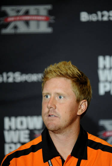 Oklahoma State quarterback Brandon Weedon answers questions during NCAA college football Big 12 Media Days, Monday, July 25, 2011, in Dallas. (AP Photo/Matt Strasen)