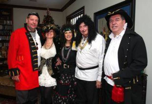 Rick and Diana Hudak, Barbara and Gary McNeill, Jack Baker show their costumes for the event.