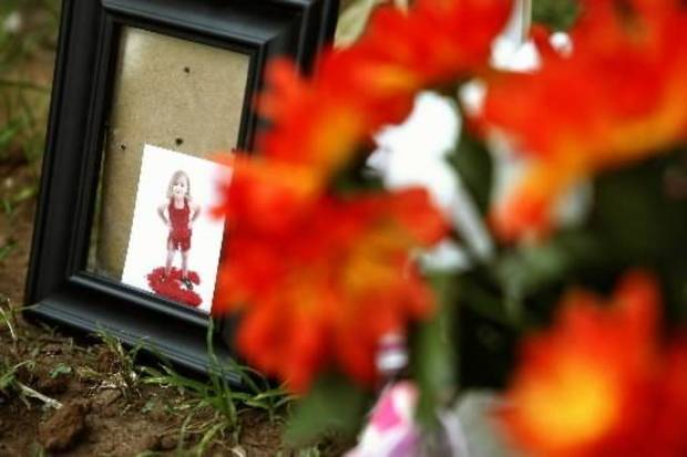 A memorial is set up in front of an apartment on East Drive for 5-year-old Serenity Deal, who died after suffering physical abuse. Police arrested Deal's father, Sean Devon Brooks, 31, on complaints of murder and child abuse on Monday, June 6, 2011. Photo by Zach Gray