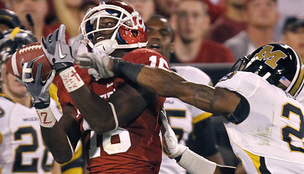 Oklahoma's Jazz Reynolds (16) pulls in a pass in front of Missouri's Trey Hobson (21) during the college football game between the University of Oklahoma Sooners (OU) and the University of Missouri Tigers (MU) at the Gaylord Family-Memorial Stadium on Saturday, Sept. 24, 2011, in Norman, Okla. Photo by Chris Landsberger, The Oklahoman