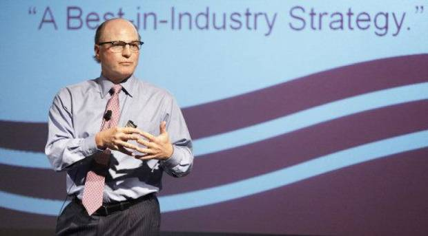 SandRidge CEO Tom Ward talks with employees about the company&#039;s shift from natural gas production to oil during a celebration in Oklahoma City , Friday, September 16, 2011. Photo by Steve Gooch  ORG XMIT: KOD
