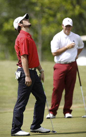 Elk City's Berek Dyson, left, shows his frustration  after missing a short putt on the front nine as Ada's Kyle Rodrigues waits his turn to putt during action in  Class 4A boy's state golf  tournament on Tuesday, May 7, 2013,  at  Hefner Golf Course in Oklahoma City.   Photo  by Jim Beckel, The Oklahoman.