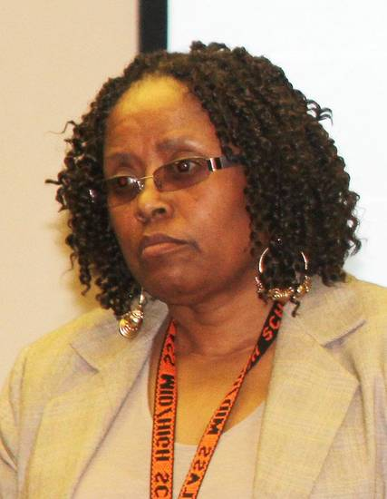 Barbara Davis, interim principal at Douglass High School, listens during a news conference to discuss the grade scandal at Douglass. Photo by Carrie Coppernoll, The Oklahoman <strong>Carrie Coppernoll</strong>