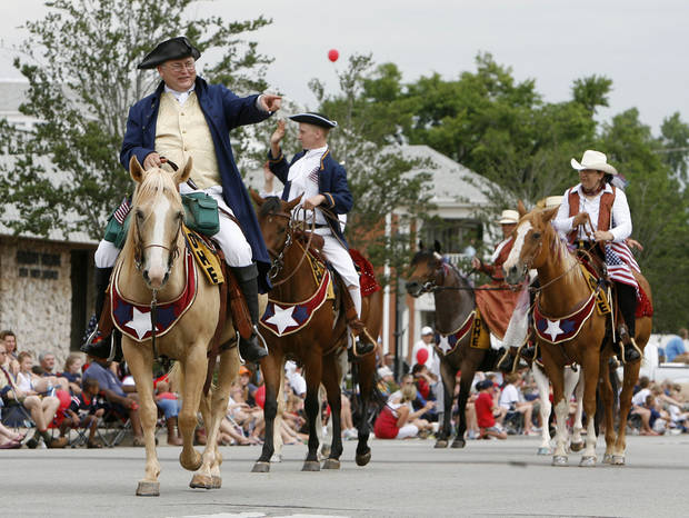 Riders in Revolutionary War attire pass down Broadway during the LibertyFest Parade in downtown Edmond, OK, Saturday, July 4, 2009. By Paul Hellstern, The Oklahoman