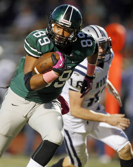 Norman North's Payton Prince (89) takes the ball for a touchdown after a catch during a high school football game between Edmond North and Norman North in Norman, Okla., Thursday, Oct. 11, 2012. Photo by Nate Billings, The Oklahoman