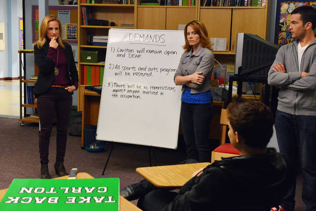"This publicity image released by ABC Family shows from left, Marlee Matlin, Katie Leclerc and Brian Gutierrez in a scene from ABC Family's TV series, ""Switched at Birth."" When news of the school's closing spreads, the students of Carlton School for the Deaf stage a protest. (AP Photo/ABC Family/Eric McCandless)"