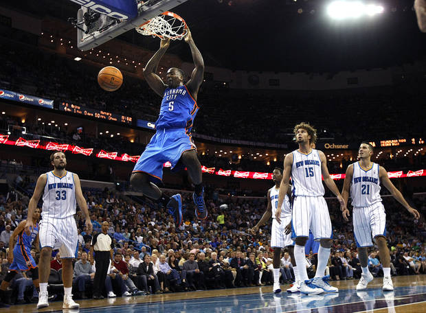 Oklahoma City Thunder center Kendrick Perkins (5) slam dunk in front of New Orleans Hornets forward Ryan Anderson (33), forward Al-Farouq Aminu (0), guard Greivis Vasquez (21) and center Robin Lopez (15) in the first half of an NBA basketball game in New Orleans, Saturday, Dec. 1, 2012. (AP Photo/Gerald Herbert) ORG XMIT: LAGH109