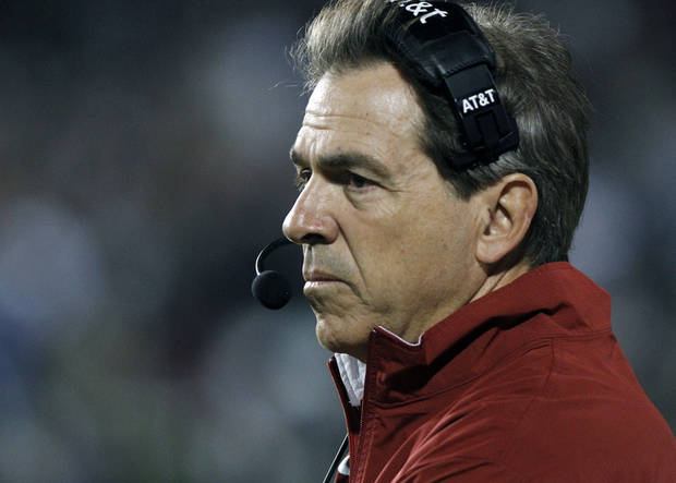 Alabama football coach Nick Saban stares at his players in their NCAA college football game against Mississippi State in Starkville, Miss., Saturday, Nov. 12, 2011. No. 4 Alabama won 24-7. (AP Photo/Rogelio V. Solis) ORG XMIT: MSRS118