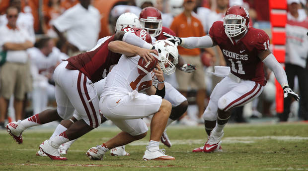 OU&#039;s Chuka Ndulue (98) and R.J. Washington (11) put pressure on UT&#039;s David Ash (14) during the Red River Rivalry college football game between the University of Oklahoma (OU) and the University of Texas (UT) at the Cotton Bowl in Dallas, Saturday, Oct. 13, 2012. Photo by Chris Landsberger, The Oklahoman
