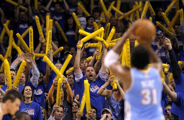 Fans try to distract Denver&#039;s Nene (31) during the first round NBA basketball playoff game between the Oklahoma City Thunder and the Denver Nuggets on Wednesday, April 20, 2011, at the Oklahoma City Arena. Photo by Sarah Phipps, The Oklahoman