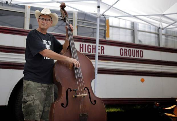 Steve Huhn plays music at the campgrounds during the Woody Guthrie Festival in Okemah, Okla., Friday, July 11, 2014. Photo by Sarah Phipps, The Oklahoman