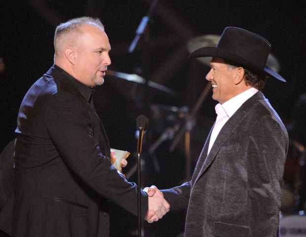 FILE - This April 6, 2009 file photo shows musician Garth Brooks, left, presenting George Strait with the Artist of the Decade award at the ACM Artist of the Decade All Star Concert in Las Vegas. Brooks and Strait will perform together for a tribute to the late Dick Clark at the 48th Annual Academy of Country Music Awards on April 7, 2013 in Las Vegas. (AP Photo/Mark J. Terrill) ORG XMIT: NYET264