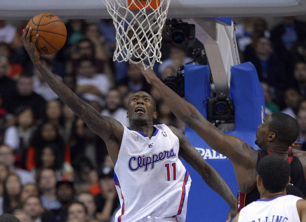 Los Angeles Clippers guard Jamal Crawford, left, puts up a shot as Miami Heat center Chris Bosh defends during the second half of their NBA basketball game, Wednesday, Nov. 14, 2012, in Los Angeles. The Clippers won 107-100. (AP Photo/Mark J. Terrill)  ORG XMIT: LAS114