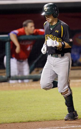 Baylor's Landis Ware runs past the KU dugout after hitting a two-run home run in the sixth inning during the Big 12 baseball championship tournament game between Baylor and Kansas at the Bricktown Ballpark in Oklahoma City, Saturday, May 29, 2010. Photo by Nate Billings, The Oklahoman