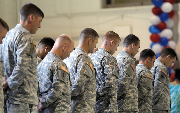 during a Oklahoma Aviation Command mobilization ceremony  for Detachment 1, Company C, 2-149th General Support Aviation Battalion at the Army Aviation Support Facility in Lexington, Okla., Sunday, Sept. 16, 2012. The soldiers will receive additional training at Fort Hood before being deployed to Afghanistan. Photo by Sarah Phipps, The Oklahoman
