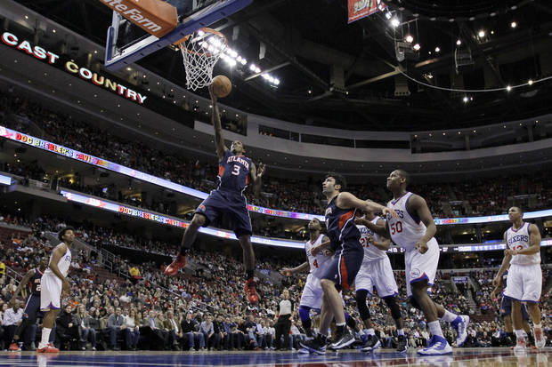 Atlanta Hawks' Louis Williams goes up for a shot in the first half of an NBA basketball game against the Philadelphia 76ers, Friday, Dec. 21, 2012, in Philadelphia. (AP Photo/Matt Slocum)