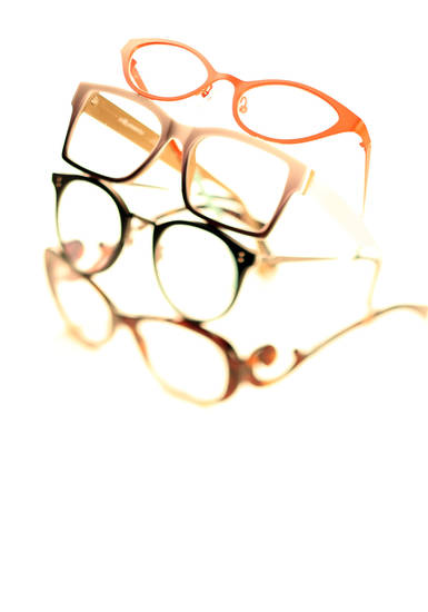 Eyelgasses have gone from nerd necessity to fashion accessory. Shown, from top, are two pairs from l.a. Eyeworks, Oliver Peoples and Prada. (Kirk McKoy/Los Angeles Times/MCT)