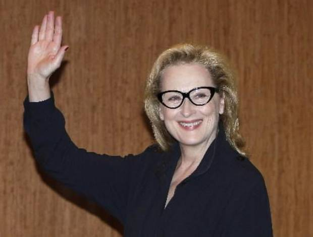 "In this March 7, 2012 file photo, Academy Award winning actress Meryl Streep waves during a press conference to promote their movie ""The Iron Lady"" in Tokyo, Japan. Last weekend Streep, along with Secretary of State Hillary Rodham Clinton participated the Women in the World summit, a three-day gathering prominent women leaders. (AP Photo/Shizuo Kambayashi)"