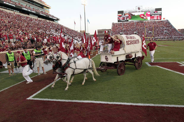 Ruff/Neks drive the Sooner Schooner after a touchdown during the first half of the college football game where the University of Oklahoma Sooners (OU) play the University of Louisiana Monroe Warhawks at Gaylord Family-Oklahoma Memorial Stadium in Norman, Okla., on Saturday, Aug. 31, 2013. Photo by Steve Sisney, The Oklahoman