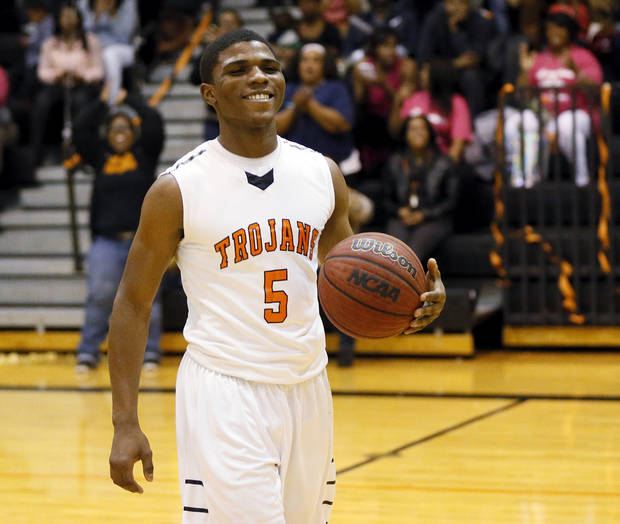 Douglass' Stephen Clark (5) smiles as he is recognized for scoring the 3,000th point of his career during a boys high school basketball game between Douglass and Northeast at Douglass High School in Oklahoma City, Friday, Feb. 8, 2013. Photo by Nate Billings, The Oklahoman