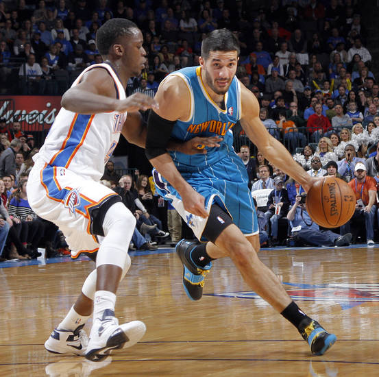 Oklahoma City Thunder's Reggie Jackson (15) defends on New Orleans Hornets' Greivis Vasquez (21) during the NBA basketball game between the Oklahoma CIty Thunder and the New Orleans Hornets at the Chesapeake Energy Arena on Wednesday, Dec. 12, 2012, in Oklahoma City, Okla.   Photo by Chris Landsberger, The Oklahoman