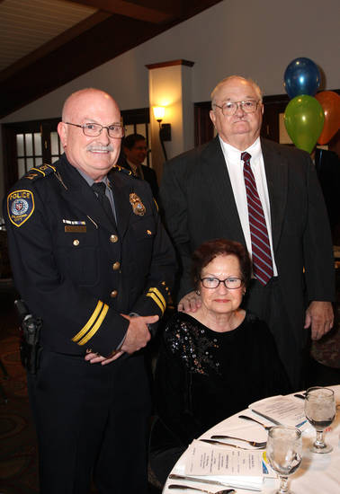 Captain Robert Nash, Carol and Jim Hetherington. Photo by David Faytinger for the Oklahoman____