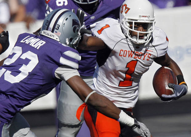 Oklahoma State's Joseph Randle (1) looks for running room past Kansas State's Emmanuel Lamur (23) during the first half of the college football game between the Oklahoma State University Cowboys (OSU) and the Kansas State University Wildcats (KSU) on Saturday, Oct. 30, 2010, in Manhattan, Kan.   Photo by Chris Landsberger, The Oklahoman