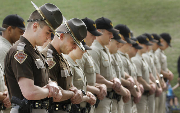 Members of The Oklahoma Highway Patrol and OHP recruit class bow their heads during prayer at the Oklahoma Law Enforcement Officers Memorial Service in Oklahoma City , Friday, May 10, 2013. Photo By Steve Gooch, The Oklahoman