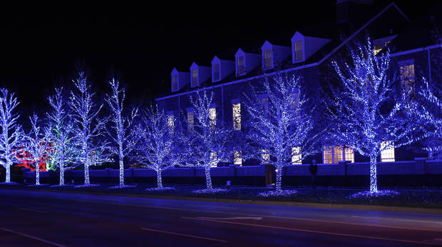 Trees covered with Christmas lights throw a blue hue on a Chesapeake building along Western Avenue  Wednesday, December 5, 2012. Photo by Doug Hoke, The Oklahoman