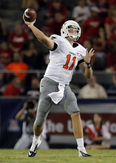 Oklahoma State&#039;s Wes Lunt (11) throws during the college football game between the University  of Arizona and Oklahoma State University at Arizona Stadium in Tucson, Ariz.,  Saturday, Sept. 8, 2012. Photo by Sarah Phipps, The Oklahoman