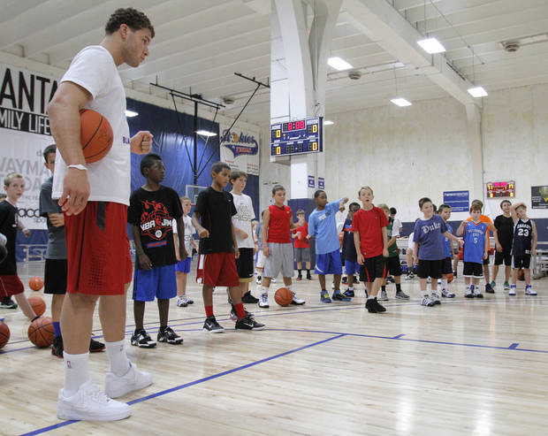 Blake Griffin gives camp participants advice during the Blake Griffin basketball camp at the Santa Fe Family Life Center in Oklahoma City Thursday, Aug. 4, 2011.  Photo by Garett Fisbeck, The Oklahoman