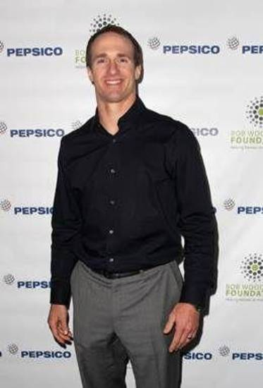 New Orleans Saints quarterback Drew Brees arrives at the event.