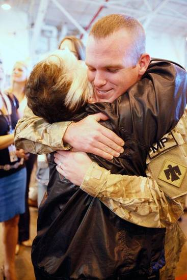 Cpl. Joseph English gets a hug from his grandmother Barbara English as Oklahoma National Guard soldiers return from Afghanistan to a welcome home ceremony in Oklahoma City, Tuesday, March 13, 2012,  By Paul Hellstern, The Oklahoman
