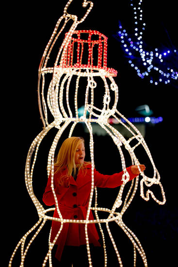 CHILD / CHILDREN / KIDS / HOLIDAY / CHRISTMAS LIGHTS: Annie Davis, 9, stands inside a lighted snowman during the Mayor's Tree Lighting at Shannon Miller Park in Edmond, Okla., Saturday, Dec. 8, 2012. Photo by Bryan Terry, The Oklahoman