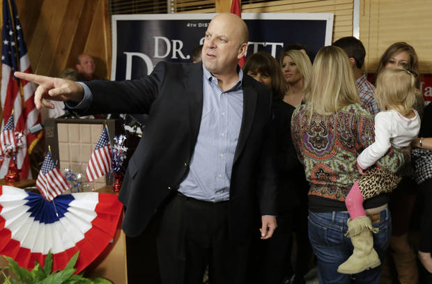 "** FILE ** In this Nov. 6, 2012 file photo, U.S. Rep. Scott DesJarlais, R-Tenn., greets supporters on election night in Winchester, Tenn. DesJarlais defeated Democrat Eric Stewart in the state's 4th Congressional District race. DesJarlais testified during divorce proceedings that he and his former wife made a ""mutual"" decision for her to have two abortions, according to divorce transcripts released Thursday, Nov. 15, 2012. (AP Photo/Mark Humphrey)"