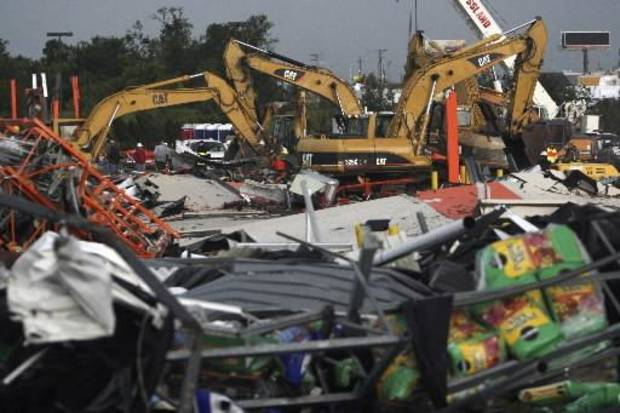 Bulldozers sift through the rubble of a collapsed Home Depot store in Joplin, Mo., Monday, May 23, 2011. A destructive tornado swept through Joplin on Sunday evening, killing at least 116 and injuring hundreds more. (AP Photo/Mark Schiefelbein)