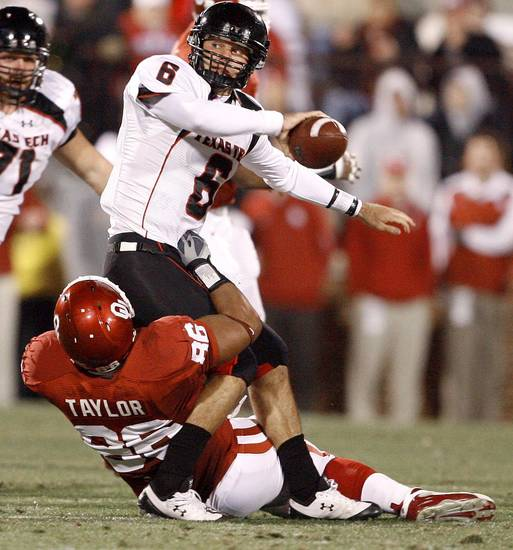 Graham Harrell of Texas Tech tries to get rid of the ball as OU's Adrian Taylor tries to bring him down during the college football game between the University of Oklahoma Sooners and Texas Tech University at Gaylord Family -- Oklahoma Memorial Stadium in Norman, Okla., Saturday, Nov. 22, 2008. BY BRYAN TERRY, THE OKLAHOMAN