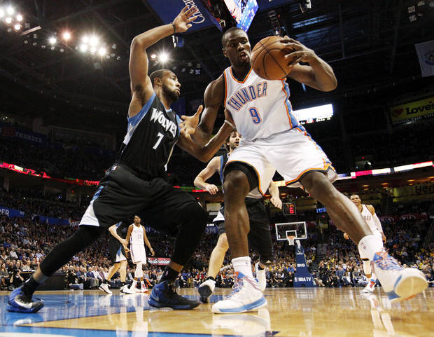 Oklahoma City's Serge Ibaka (9) works against Minnesota's Derrick Williams (7) during an NBA basketball game between the Oklahoma City Thunder and Minnesota Timberwolves at Chesapeake Energy Arena in Oklahoma City, Friday, Feb. 22, 2013. Photo by Nate Billings, The Oklahoman