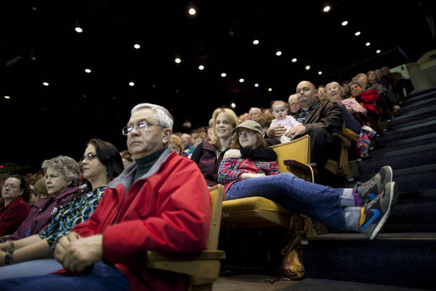 People listen to Republican presidential candidate, former House Speaker Newt Gingrich speak during a town hall at Oral Roberts University on Monday, Feb. 20, 2012 in Tulsa, Okla.  (AP Photo/Evan Vucci) ORG XMIT: OKEV107