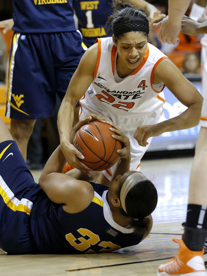 Oklahoma State's Brittney Martin (22) and West Virginia's Ayana Dunning (33) fight for the ball during a women's college basketball game between Oklahoma State and West Virginia at Gallagher-Iba Arena in Stillwater, Okla.,  Tuesday, Jan. 29, 2013. Photo by Bryan Terry, The Oklahoman