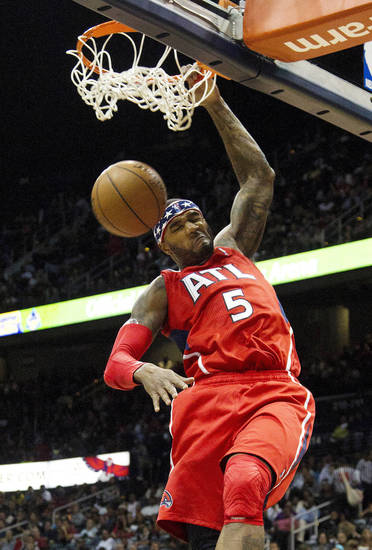 Atlanta Hawks forward Josh Smith (5) dunks in the first half of an NBA basketball game against the Miami Heat in Atlanta, Friday, Nov. 9, 2012. (AP Photo/John Bazemore)