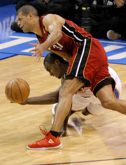 Oklahoma City's Serge Ibaka (9) goes for the ball under Miami's Shane Battier (31) during Game 1 of the NBA Finals between the Oklahoma City Thunder and the Miami Heat at Chesapeake Energy Arena in Oklahoma City, Tuesday, June 12, 2012. Photo by Sarah Phipps, The Oklahoman