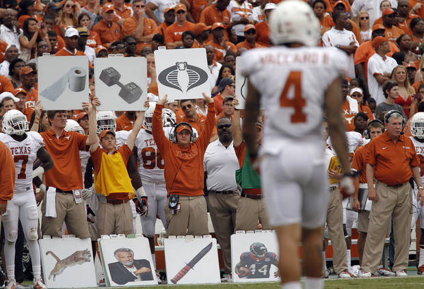 The Texas coaching staff calls in the plays during the Red River Rivalry college football game between the University of Oklahoma (OU) and the University of Texas (UT) at the Cotton Bowl in Dallas, Saturday, Oct. 13, 2012. Photo by Chris Landsberger, The Oklahoman