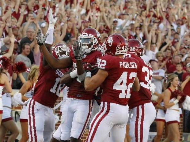 Oklahoma wide receiver Justin Brown (19) celebrates with Lacoltan Bester (18) and Oklahoma defensive back Jesse Paulsen (42) after a long return against Florida A&amp;M in Norman, Okla., Saturday, Sept. 8, 2012. (Photo by Bryan Terry, The Oklahoman)